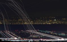Long exposure of planes departing and arriving.