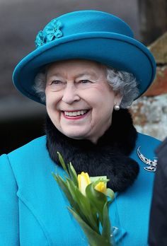 "Blue with a hint of yellow -- Queen Elizabeth - ""Fashion and graceful aging"" with a beautiful smile."