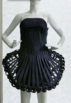You can do this as a skirt with flexible tubing and sturdy ribbons.