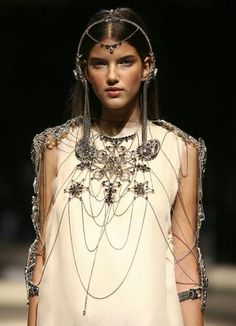 A model wears catwalk jewelry by Jean-Paul Gaultier, commissioned by Swarovski for its Swarovski Runway Rocks: two bracelets, a headpiece, a necklace and a shoulder piece. It will be presented during