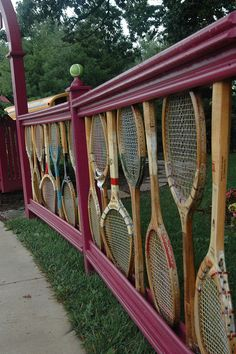 Tennis, Anyone?     recycled equipment used as a fence - clever and unique -
