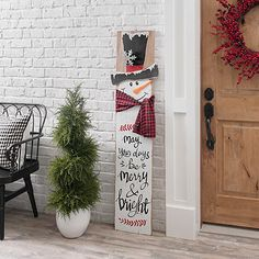 May your days be merry and bright with our Snowman with Scarf Porch Board on display! You'll love its wood plank design resting against your porch bench! Diy Xmas, Christmas Wood Crafts, Christmas Signs Wood, Christmas Porch, Snowman Crafts, Outdoor Christmas Decorations, Rustic Christmas, Christmas Projects, Holiday Crafts