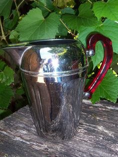 Beautiful Chromium Pitcher with Red Bakelite by SylviasFinds, $20.00