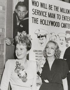 Deanna Durbin & Marlene Dietrich at the Hollywood Canteen, 1943 movie star vintage fashion history icons 40s war era photo print ad promo War Era WWII dress hairstyle flower corsage
