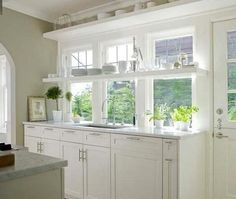 I want a window this large when I redo my kitchen.  So bright and airy.