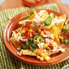 Preheat oven to 350 degrees F. Lightly grease a 3-quart rectangular baking dish. Place 3 cups of the tortilla chips in bottom of prepared dish.