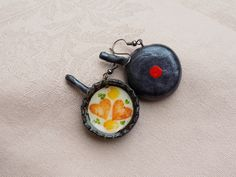'Fried Eggs Served in a Pan' earrings. Bottle Cap Earrings, Fried Eggs