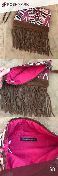 American Eagle fringe wristlet Adorable American Eagle wristlet, perfect for an afternoon out or for makeup. Whatever you want! American Eagle Outfitters Bags Clutches & Wristlets