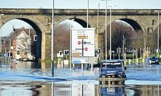 A motorist drives through the flood waters on Kirkstall Road in central Leeds on 27 December. Northern England, Leeds, The Guardian, Mother Earth, Fails, Britain, Environment, It Cast, Army