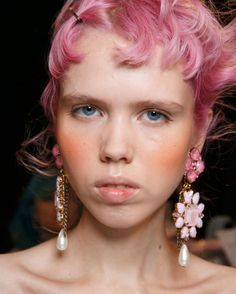 One of this season's hottest trends - take your blusher down your cheeks and up to your temples for a nod to the 80s and a youthful flush. Quite literally the blushing bride.
