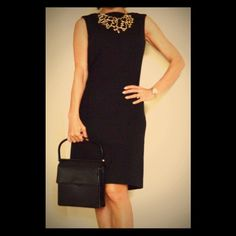 Georgio Armani classy little black dress Simple and elegant. Less is more. Front pocket for your id and Benjamin. ;) Giorgio Armani Dresses