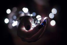 #art #blur #bokeh #bright #bulb #celebration #christmas #close up #color #concert #creativity #dark #design #electric #electrical #electricity #energy #focus #glisten #glowing #hand #idea #illumination #lights #luminesce