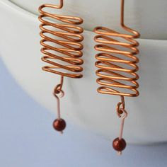 Simply elegant & beautiful earrings, drop & dangle earrings, minimalist style earrings, treasures for her, unique & lovely earrings, wire-wrapped earrings, handmade, handcrafted copper wire-wrapped light as a feather Each piece is handcrafted including the ear wire. Created to simplify