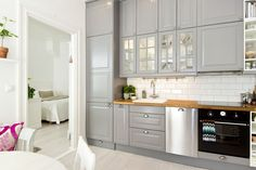 Grey kitchen. Cabinets. Glossy. Decor. Modern. Design. Interior.