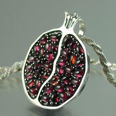 Oh, how I want this!  JUICY POMEGRANATE silver garnet pendant. $400.00, via Etsy.