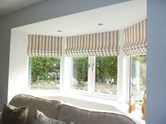 Neutral palette of soft stripes and gentle cascades in this three facet bay #romanblindwizard #roman #shade #blind #cascading
