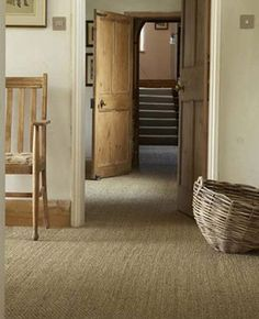 wall to wall carpet, door details, love the colors, wooden baseboards