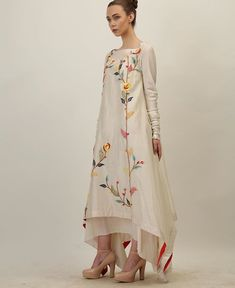 Beautiful asymmetric Silk Kurti with brilliant multicolor embroidery. Shades of summer.