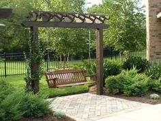 Pin from www.backyardlivingllc.com. Arbor with swing.