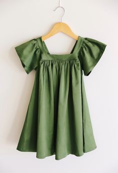 This dress is a cotton/satin/spandex blend. Wash cold and lay flat to dry. The Holly Dress has plenty of room to grow and we suggest to size down from your little's regular size. Toddler Christmas Dress, Poppy Dress, Room To Grow, Flutter Sleeve, Poppies, Fashion Outfits, Clothing Styles, Celebrities, Sewing Ideas