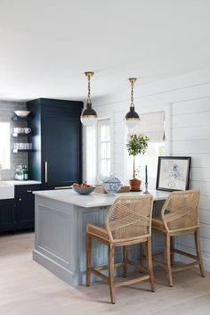 hamptons blue kitchen with gorgeous painted cabinets, light blue tile backsplash, shiplap and touches of gold.