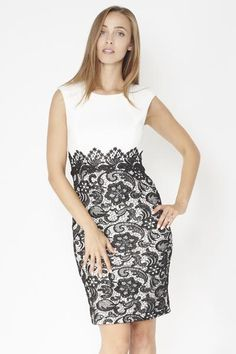 Laced Skirt Pencil Dress. A gorgeous below the knee sleeveless pencil dress with laced lower skirt detailing. This is a classy dress that when worn is sure to get you noticed, and is perfect for formal occasions or important nights out.