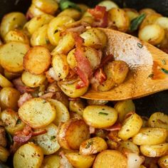Pan-fried fingerling potatoes with bacon, fresh rosemary, and sage! Use baby potatoes in place of the fingerling. Easy and quick dish.
