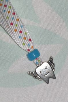 Magical Dental Bravery Necklace. To help the child to be brave in the dentist's chair. Would be a nice gift from the Tooth Fairy for the first tooth. Oh! Maybe the Tooth Fairy could leave one for each of the younger siblings as well! No longer available from etsy. Make something similar?