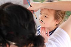Fancy a moustache? Childrens face painting moustaches in the childrens garden.