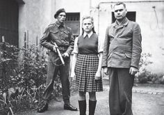A British soldier guards Bergen-Belsen warden Irma Grese, 22, photographed in August 1945 with Josef Kramer, the commandant of the concentration camp Photo By: COURTESY IMPERIAL WAR MUSEUM