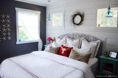 dark gray walls, white trim, and white wood plank wall