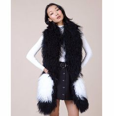 Charlotte Simone  Black & White  Wool Pocket Monster Scarf: Seamlessly combining comfort, style and functionality, the Pocket Monster from Charlotte Simone is the perfect winter accompaniment. The monochrome colour makes this item easy to pair with almost anything, along with it looking super glam, it also acts as 2 in 1, the pockets will keep your hands warm whilst also having them ready for all those fiddly tasks that gloves just aren't ideal for. Along with its classic look, the inside…