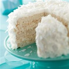 "White Chocolate Coconut Cake Recipe -This eye-catching cake is my own creation. The white ""snowball"" look makes it the perfect choice for a holiday celebration. —Greta Kirby, Carthage, Tennessee"