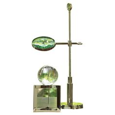 Add eclectic appeal to your home library or office with this nickel-plated magnifying glass, showcasing an adjustable design and a sophisticated silhouette.