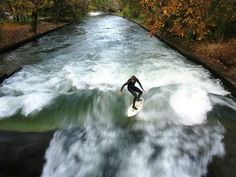 Munich - surfing on the Eisbach - a man-made river. This was one of the coolest, unexpected sites I saw in Germany. Great Places, Places To See, Places Ive Been, Beautiful Places, Places To Travel, Cool Pictures, Around The Worlds, Vacation, Adventure