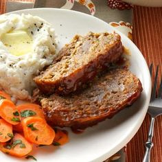 Best-Ever Meat Loaf Recipe -The combination of onion, carrots, parsley and cheese—plus the tomato-mustard topping—makes this meat loaf unusually colorful. It's an attractive entree to serve, and it has a unique, unforgettable flavor. The recipe lends itself easily to being doubled or halved to suit the number you're cooking for, and it also freezes well. —Anna Baker, Blaine, Washington
