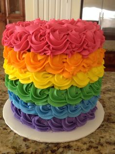 Another beautiful and colorful rainbow cake perfect for a My Little Pony birthday party. Moist almond cake with vanilla buttercream. Inside looks just like the outside.