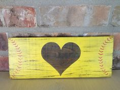 Show the world you love softball with this cute softball sign. Made from reclaimed wood, the sign measures about 5.5 x 13.5 x .75 Prop on a
