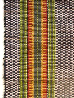 """Home furnishings: Worn-out clothing was never wasted in Pennsylvania German households. Often it was woven into rugs. This modern example of a """"rag rug"""" was made by weaver Rebecca Francis using recycled corduroy pants and natural yarns."""
