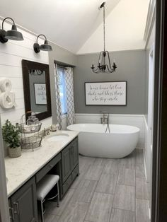 Tongue and groove accent wall, slab tile and grey wall colour 😍 Bathroom Renos, Shiplap Master Bathroom, Paint Bathroom Cabinets, Basement Bathroom Ideas, Clawfoot Tub Bathroom, Master Bath Tile, Bathroom Towel Hooks, Bathtub, Bathroom Goals