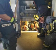 Kansas City fire department saves Kansas City police department from elevator.