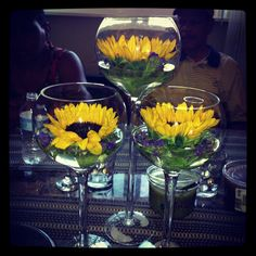 Loving my floating fresh sunflowers, perfect centerpiece for fall:) Add some glass rocks to the bottom to make it complete:)