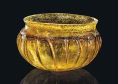 A ROMAN AMBER GLASS RIBBED BOWL CIRCA MID-1ST CENTURY A.D.