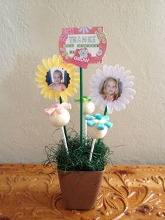 """End of the year """"Thanks for helping me grow"""" teacher gift.  Cake pops to look like flowers, a picture of the student on 1st day of school and another toward the end of the school year, and the two flowers holding gift cards."""