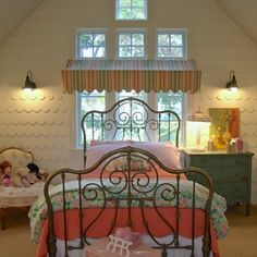 "Scalloped shingles, gooseneck barn lights, and an awning over the headboard make a fanciful, vintage ""dollhouse"" bedroom"