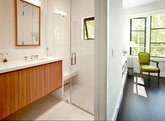 white bathroom, modern wood cabinets, glass shower enclosure