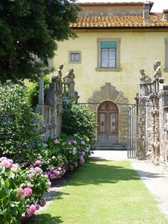 Villa Gamberaia ~ Florence, Tuscany, Italy. Combines several themes I've noticed. Long view with focal point, busts or urns on stone wall and a gate.