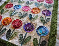 I quilted the ribbon candy design in the inner border and a alternating leaf in the outer border to finish it off.