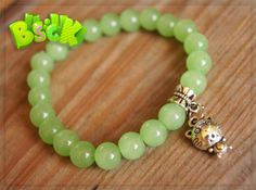 jade bracelet  Materials: natural stone jade (nephrite), silicone rubber, suspension of Tibetan silver. Size of beads: 8 mm.