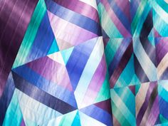 """A precut-friendly pattern with seamless blends of jewel tone hues. Split Square Jewel Quilt Kit by Monique Dillard featuring Boundless Ombre Jewel 6"""" Strips (2 sets) 64 x 74"""""""